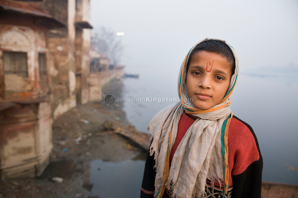 Portrait of a young boy on the bank of the Yamuna, River.