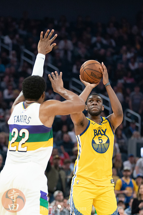 February 23, 2020; San Francisco, California, USA; Golden State Warriors forward Kevon Looney (5) shoots the basketball against New Orleans Pelicans center Derrick Favors (22) during the second quarter at Chase Center.