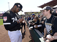 GLENDALE, ARIZONA - FEBRUARY 23:  Eloy Jimenez #74 of the Chicago White Sox signs an autograph prior to the game against the Los Angeles Dodgers on February 23, 2019 at Camelback Ranch in Glendale Arizona.  (Photo by Ron Vesely)  Subject:  Eloy Jimenez