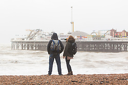 © Licensed to London News Pictures. 06/12/2015. Brighton, UK. Members of the public watch the powerful waves that hit Brighton seafront as the South Coast gets some of the fallout of storm Desmond. Today December 6th 2015. Photo credit: Hugo Michiels/LNP