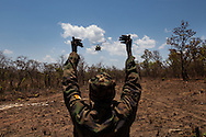 A UPDF soldier signals to a helicopter to land at Landing Zone hacked into the bush by the soldiers in Central African Republic.The ability to airlift out and treat wounded UPDF soldiers has made a large difference in moral for the troops who are now able to be more aggressive in their effort to hunt down members of the LRA. Although the UPDF has been chasing Kony for decades, renewed international interest and increased funding from the US have brought the most pressure on Joseph Kony in decades.