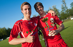 Nejc Pecovnik and David Lonzaric celebrate with a trophy after the football match between NK Aluminij Kidricevo and NK Roltek Dob in 27th, last Round of 2nd SNL, on May 19, 2012 in Sports park Kidricevo, Slovenia. NK Aluminij defeated NK Dob 2-1, won 2nd SNL and qualified to 1st SNL. (Photo by Vid Ponikvar / Sportida.com)