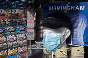 With new local coronavirus lockdown measures now in place and Birmingham currently set at 'Tier 2' or 'high', a souvenir shop selling face masks in the city centre on 14th October 2020 in Birmingham, United Kingdom. This is the first day of the new three tier system in the UK which has levels: 'medium', which includes the rule of six, 'high', which will cover most areas under current restrictions; and 'very high' for those areas with particularly high case numbers. Meanwhile there have been calls by politicians for a 'circuit breaker' complete lockdown to be announced to help the growing spread of the Covid-19 virus.