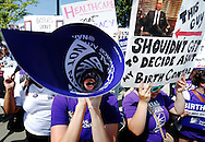 Demonstrators in support of abortion and contraceptive rights chant for their cause after the Hobby Lobby ruling outside the U.S. Supreme Court in Washington.