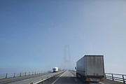 Crossing the Great Belt Bridge  Storebæltsbroen connecting Zealand in the East to West Denmark. The crossing is 18 km long and the suspension part 1.6km long making it the third longest in the world.