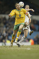 Photo: Aidan Ellis.<br /> Leeds United v Norwich City. Coca Cola Championship. 11/03/2006.<br /> Norwich's Darren Huckerby and Leeds Gary Kelly battle for the ball