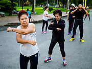 05 JUNE 2017 - BANGKOK, THAILAND:  Older Thai adults participate in an aerobics class in Lumpini Park in Bangkok. Thai health officials estimate that about 17% of Thais are 60 years old and older, putting Thailand right on the cusp of being an aging society. Many public health centers and government offices in Thailand offer free exercise classes for Thai seniors in an effort to keep older Thais healthy and mobile.     PHOTO BY JACK KURTZ