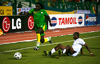 Coly of Senegal retrieves the ball from Ghana