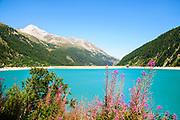 Austria, Zillertal High Alpine nature Park Hochgebirgs Naturpark Schlegeis dam and reservoir with the Schlegeis glacier in the background