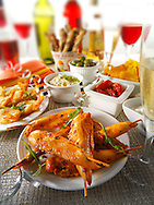 Party food with chicken satay and tappas