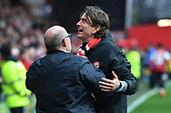 Brentford Manager Thomas Frank celebrates their 3-0 victory with a fan after the EFL Sky Bet Championship match between Brentford and Queens Park Rangers at Griffin Park, London, England on 2 March 2019.
