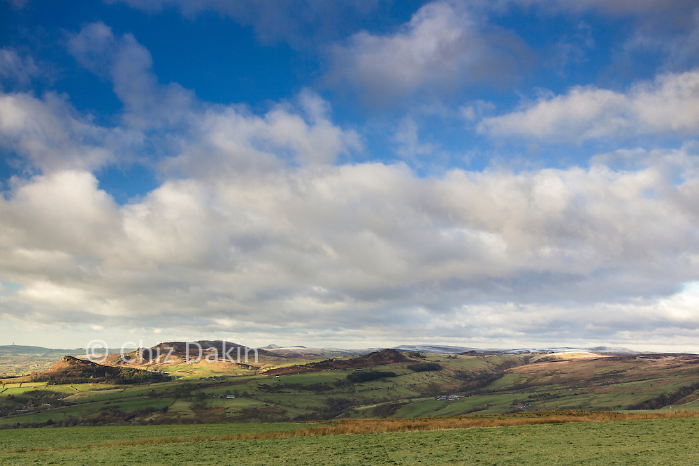 Sunlight just glimpsing off the top of Hen Cloud and the Roaches from Morridge on a very cold early winter day.