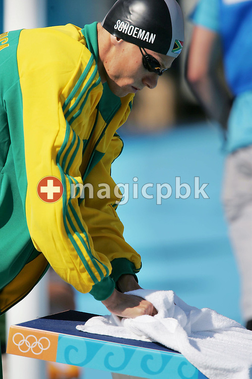 South African swimmer Roland Mark Schoeman wipes his starting block before his men's 100m Freestyle qualifying heat at the Athens Olympic Aquatic Centre, Tuesday 17 August 2004. (Photo by Patrick B. Kraemer / MAGICPBK)