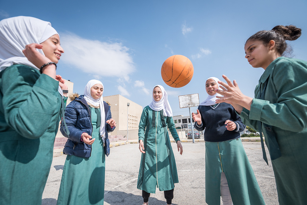 18 February 2020, Amman, Jordan: Basketball training is underway at the Rufaida Al Aslamieh Primary Mixed School in the Sahab district. The school serves more than 1,000 students from kindergarten up to 10th grade, most of them girls from Jordan but also some from Syria and other countries, and, in the lower grades, also boys.