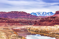 The Colorado River where it enters Lake Powell. I love photographing the American Southwest in winter because I love the juxtaposition I can capture between the colorful sandstone landscape crowned with the snow capped peaks of the mountains beyond.