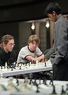 Middletown, New York - Chess champion Deepak Aaron, left, plays 32 opponents in an exhibition at Middletown High School on Saturday, Jan. 30, 2010. Aaron recently won the North American Youth Chess Championship in the Under-16 category. He is a master candidate.