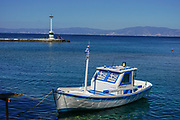 small Fishing boat at a pier in Kavala Harbor pier, East Macedonia, Greece