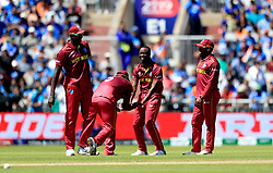 West Indies' Kemar Roach (second right) celebrates taking the wicket of India's Vijay Shankar, caught by Shai Hope, during the ICC Cricket World Cup group stage match at Emirates Old Trafford, Manchester.