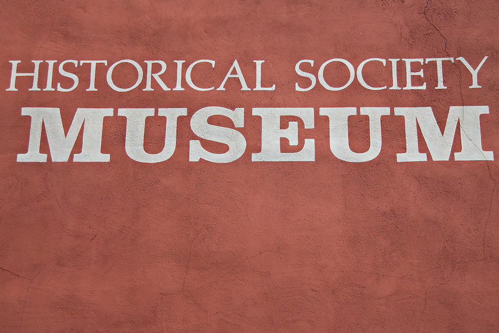 Detail of sign for Historical Society Museum in downtown Marquette Michigan.