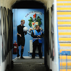 TELFORD COPYRIGHT MIKE SHERIDAN Referee Jonny Urwin shares a joke with a steward inside the unnel before the teams come out for the Vanarama National League Conference North fixture between Curzon Asthon and AFC Telford United on Saturday, November 9, 2019.<br /> <br /> Picture credit: Mike Sheridan/Ultrapress<br /> <br /> MS201920-028
