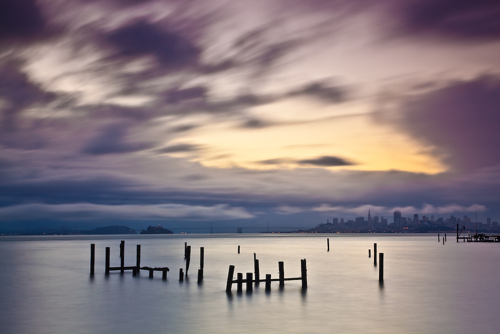 long exposure sunrise capture taken in sausalito with san francisco view and old pier in the foreground