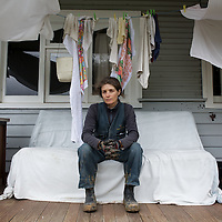 Jenn Finlay takes a break from house renovations while her washing dries under the porch at her home in the Otways town of Forrest, Victoria, Australia.