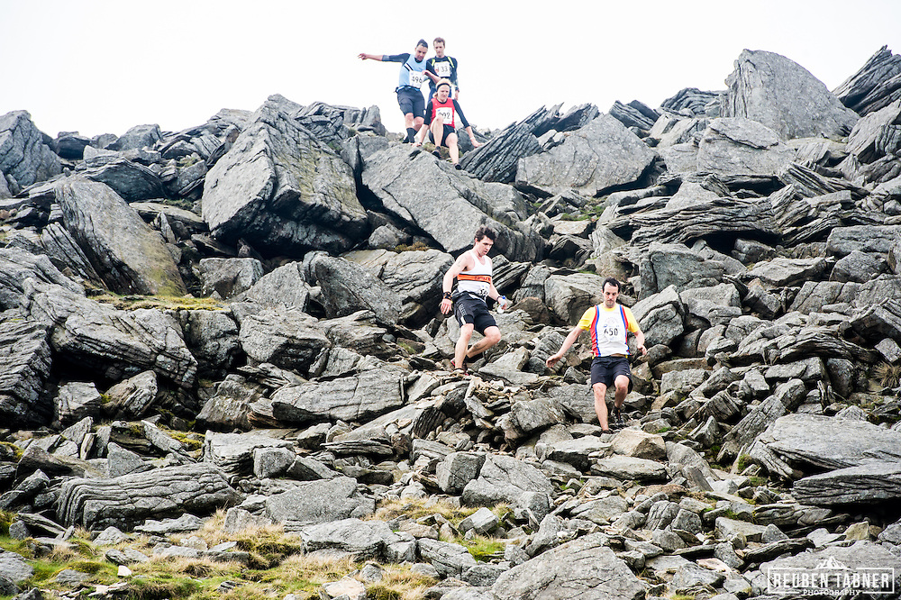 Runners pick their way down over boulders as they descend of Ingleborough in the Yorkshire Dales during the 60th Yorkshire Three Peaks Race.