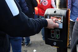 14 September 2017 - Europa League Football - Arsenal v FC Koln - A FC Koln fan sticks a club sticker on a pedestrian crossing - Photo: Charlotte Wilson