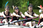 Henley. England. Women's henly Regatta<br /> Photo Peter Spurrier.<br /> Card No. 1/22<br /> <br /> Somerville College Oxford, competeing in the College eight at Women's Henley Regatta decide on a new style od headgear for their heat againstPembroke college Cambridge. 20010623 Women's Henley Regatta.