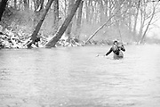 Fly Angler Mike Schmidt of Angler's Choice flies fishes for trout with a large streamer in Ohio's Mad River.