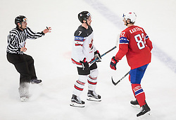 Referee, Josh Morrissey of Canada and Jorgen Karterud of Norway during the 2017 IIHF Men's World Championship group B Ice hockey match between National Teams of Canada and Norway, on May 15, 2017 in AccorHotels Arena in Paris, France. Photo by Vid Ponikvar / Sportida