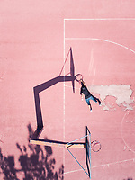 Aerial concept of a player on basketball court.