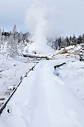 Boardwalk through Mud Volcano Thermal Area during winter in Yellowstone