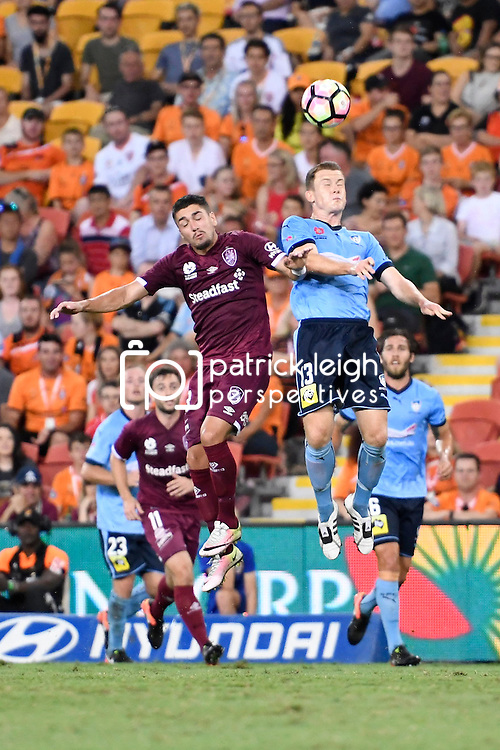 BRISBANE, AUSTRALIA - FEBRUARY 3: Dimitri Petratos of the Roar and Brandon O'Neill of Sydney compete for the ball during the round 18 Hyundai A-League match between the Brisbane Roar and Sydney FC at Suncorp Stadium on February 3, 2017 in Brisbane, Australia. (Photo by Patrick Kearney/Brisbane Roar)