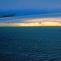 A glacier on Mabel Island, part of Russia's Franz Josef Land Archipeligo, empies into ithe Arctic Ocean.