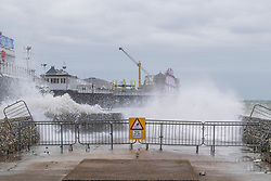 © Licensed to London News Pictures. 11/01/2020. Brighton, UK. Only a handful of people can be seen on the beach in Brighton and Hove as powerful waves are hitting the coastline grey clouds hang over the seaside resort. Photo credit: Hugo Michiels/LNP