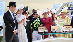 Winning jockey John Velazquez (centre) with The Duke of Cambridge (left), The Duchess of Cambridge (second left), Barbara Banke (third left) and Karin McKinnell (centre) after the King's Stand Stakes during day one of Royal Ascot at Ascot Racecourse.