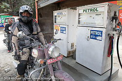 Dave Nolan at a fuel stop on Day-7 of our Himalayan Heroes adventure riding from Tatopani to Pokhara, Nepal. Monday, November 12, 2018. Photography ©2018 Michael Lichter.