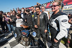 At the awards, first place finisher Brittney Olsen on her 1923 model J Harley-Davidson racer surrounded by Paul Cox, Josh Owens, Billy Lane, Shelly Rossmeyer and all the other racers just after Billy's Son's of Speed race during Daytona Bike Week. New Smyrna Beach, FL. USA. Saturday March 18, 2017. Photography ©2017 Michael Lichter.