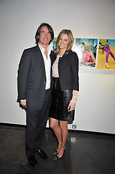 TIM JEFFERIES and his wife MALIN at an exhibition of photographs by Miles Aldridge held at Hamiltons, Carlos Place, London on 31st March 2009.