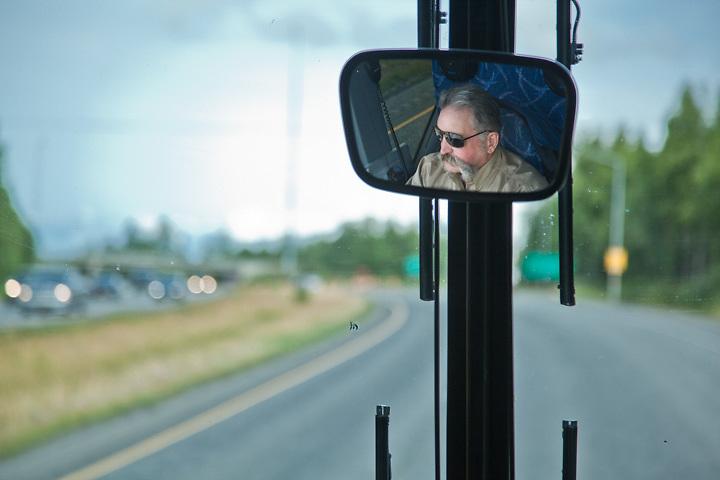 Bob Bauer, drives his Royal Caribbean Motor Coach north, near Willow, Alaska.  Royal Caribbean and Celebrity Cruises Alaska Excursions.