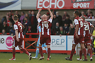 Matt Richards of Cheltenham (c) celebrates scoring his side's match winning goal. Skybet football league two match, Cheltenham Town v Torquay Utd at the Abbey Business stadium, Whaddon Rd in Cheltenham on Saturday 15th March 2014.<br /> pic by Mark Hawkins, Andrew Orchard sports photography.
