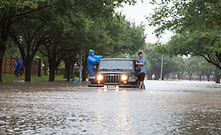 August 29, 2017 - Houston, Texas, U.S. - Residents in Katy's Grand Lakes ride on the sides of a jeep through the flood waters during Hurricane Harvey. (Credit Image: © John Glaser/CSM via ZUMA Wire)