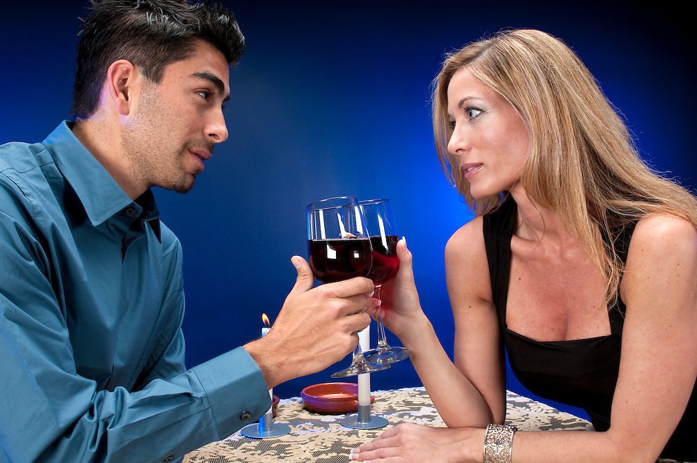 Multiracial couple dating in night club or restaurant setting.