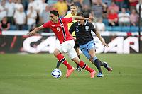 Norway - England.<br /> Ullevaal Stadium, Oslo, Norway.<br /> <br /> 26.05.2012<br /> Photo. Simon Rogers, Digital Sport.<br /> <br /> Norway. Mohammed Abdellaoue.<br /> England. Phil Jagielka.