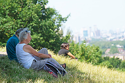 ©Licensed to London News Pictures 22/06/2020<br /> Greenwich, UK. People sitting in the shade. A warm sunny day in Greenwich park, Greenwich, London. The UK to enjoy hot heatwave weather this week with temperatures set to bring the hottest day of the year so far. Photo credit: Grant Falvey/LNP