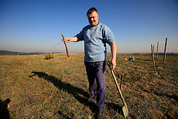 CZECH REPUBLIC VYSOCINA NEDVEZI 11APR09 - Tree planting on a hill near the village of Nedvezi in the Czech Republic. The 'forestification' of disused agricultural land is sponsored by funds from the European Union and many villagers participate in the planting of pine trees during the Easter weekend...jre/Photo by Jiri Rezac..© Jiri Rezac 2009