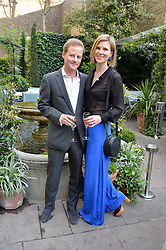 GUY & LIZZIE PELLY at a party to celebrate 'A Year In The Garden' celebrating the first year of The Ivy Chelsea Garden, 197 King's Road, London on 16th May 2016.