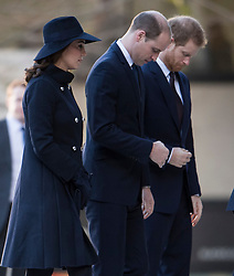© Licensed to London News Pictures. 14/12/2017. London, UK. CATHERINE, DUCHESS OF CAMBRIDGE, PRINCE WILLAM and PRINCE HARRY arrive at St Paul's Cathedral in London for a Grenfell Tower National Memorial Service to mark the six month anniversary of the Grenfell Tower fire. The service is attended by survivors of the fire and relatives of those who lost their lives in the fire, as well as members of the emergency services and members of the Royal family.  Over 70 people were killed when a huge fire ripped though 24-storey Grenfell Tower block in west London in June 2017.   Photo credit: Ben Cawthra/LNP
