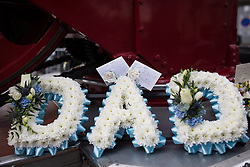 © Licensed to London News Pictures . 02/09/2013 . Bury , UK . Flowers and tributes . The funeral of fireman Stephen Hunt at Bury Parish Church today (Tuesday 3rd September 2013) . Stephen Hunt died whilst tackling a blaze at Paul's Hair World in Manchester City Centre in July 2013 . Photo credit : Joel Goodman/LNP